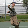 Gloucester: Luke Gillette, 11, of Gloucester jumps up to return a serve while playing tennis with his friend Anthony Asaro, 11, at the tennis courts on Stacy Boulevard Thursday afternoon. Mary Muckenhoupt/Gloucester Daily Times