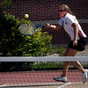 Gloucester: Rockport's Morgan Weir reaches for a wide shot while playing Gloucester's Leila Gaston at Gloucester High School yesterday. Photo by Kate Glass/Gloucester Daily Times Thursday, May 21, 2009