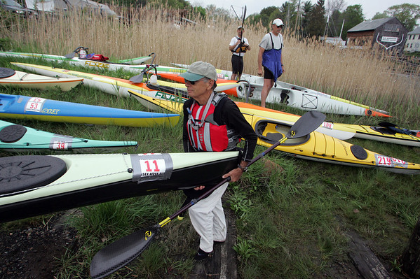 Essex: Jonathan Rose carries his kayak to the river before the Essex River Race Saturday morning. The race is 5.5 mile open water race that was open to all  human powered boats which included kayaks, row boats, dory and seine boats. Mary Muckenhoupt/Gloucester Daily Times