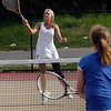 Gloucester: Gloucester's Emily Philpott goes to the net and slams a winner in her doubles match with partner Meg Muniz (not shown) as they play Danvers yesterday afternoon. Photo by Kate Glass/Gloucester Daily Times Wednesday, May 20, 2009
