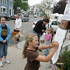 Rockport: Haley New, 8, of Manchester draws Motif No. 1 from Dock Square during Motif No. 1 Days Saturday.  You could draw Motif No. 1 and take it with you or leave it on the drawing pad for prosterity. Standing left is Haley's sister Lexi, 10.  Mary Muckenhoupt/Gloucester Daily Times