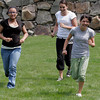 Manchester: Beverly Clark, Cardine Gaipo and Sabrina Cottone race across the lawn at the Manchester Athletic Club as they participate in the Club's Enrichment Program. Photo by Kate Glass/Gloucester Daily Times