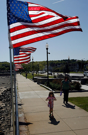 Gloucester: Andriana Bruno, 6, of Gloucester rides her scooter down the Boulevard as Maria Zervos walks alongside her yesterday afternoon. The flags were raised yesterday in preparation for Memorial Day. Photo by Kate Glass/Gloucester Daily Times Thursday, May 21, 2009