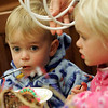 Manchester: Andrew Cahill, 20 months, watches as a table full of children work at making birds nest while at the Manchester Library with his sister Liv, 3, and mother Christina Thursday afternoon.  All ages were welcome to weave birds nests at the library using a variety of materials including yarn, rops, branches and Easter grass.  Mary Muckenhoupt/Gloucester Daily Times