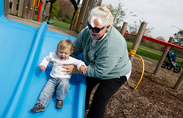 Manchester: Linda Saporito helps her grandson, Anthony Aldo Brown, 16 months, down the slide at Masconomo Park on Thursday afternoon. Brown just moved to Manchester last week. Photo by Kate Glass/Gloucester Daily Times Thursday, May 7, 2009