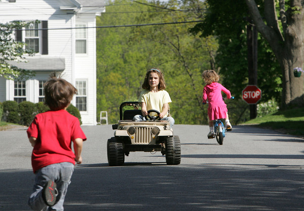 Essex: Ceana Mclaughlin, 6, of Essex rides down her street while playing with neighborhood friends Friday afternoon. Mary Muckenhoupt/Gloucester Daily Times