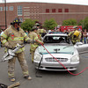 Gloucester: The Gloucester Fire Department uses the Jaws of Life to open up a car in front of seniors at Gloucester High School Friday morning. The Massachusetts State Police also gave demonstrations of seatbelt safety with a vehicle rollover simulator for juniors and seniors as part of the prom-safety demonstrations. Mary Muckenhoupt/Gloucester Daily Times