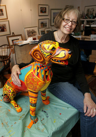 "Gloucester: Gloucester artist Marilyn Swift sits with the dog she painted for Pathways for Children in her studio Wednesday afternoon.  Pathways for Children's ""Pathways Unleashed"" features dogs painted by local artists will be exhibited throughout Cape Ann before being auctioned to the highest bidder at a gala auction. Mary Muckenhoupt/Gloucester Daily Times"