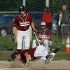 Gloucester: Gloucester's Ross Carlson rolls over home plate as he scores from second base on an overthrow to first during their game against Winthrop yesterday. Photo by Kate Glass/Gloucester Daily Times Monday, May 11, 2009