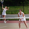Gloucester: Eleanor Keller serves as she and her doubles partner, Nicole Pyser, play Danvers yesterday afternoon. Photo by Kate Glass/Gloucester Daily Times Wednesday, May 20, 2009