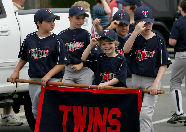 Gloucester: The Twins head down Western Boulevard suring the Little League parade Saturday afternoon.  The parade began at Burnahm's field and ended at Boudreau field with the first game of the season. Holding the banner is, from left, Cody Burke, 9, Luke Smith, 5, and Noah Smith, 9. Mary Muckenhoupt/Gloucester Daily Times
