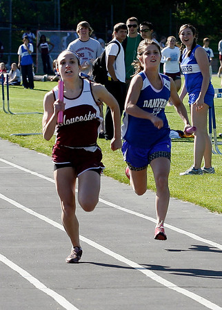 Gloucester: Gloucester's Emily Doucette and Danvers' Brittany Russo race toward the finish line in the final leg of the 4x100 relay yesterday afternoon. The Fishermen edged out the Falcons in the event 55:03 to 55:05. Photo by Kate Glass/Gloucester Daily Times Tuesday, May 19, 2009