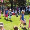 Rockport: The flower girls and flag boys decorate the unmarked grave at Beech Grove Cemetery in Rockport during the town's Memorial Day ceremony yesterday. Photo by Gail McCarthy/Gloucester Daily Times Monday, May 25, 2009