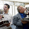 Gloucester: Gloucester Daily Times website coordinator Scott Pytlik and editor Ray Lamont kiss the trophies for CNHI website and newspaper of the year. Photo by Kate Glass/Gloucester Daily Times Tuesday, May 19, 2009