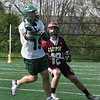 Gloucester: Manchester Essex's Cam Doane looks to pass the ball as Newburyport defender Gavin Lavalley stays close during the lacrosse game at Ed Field Field Friday afternoon.  Mary Muckenhoupt/Gloucester Daily Times