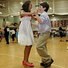 Gloucester: Matthew Gately and Miranda D'Oleo dance the Merengue at the Matt Hot Ball held at Gloucester High School Sunday afternoon.  All the Gloucester fifth graders got dressed up to show off their dance moves they  learned from weeks of dance lessons from Tina La Flam and her instructors at Miss Tina's School of Dance. The students learned such dances as the merengue, cha-cha, tango, swing dances and waltz.  Mary Muckenhoupt/Gloucester Daily Times