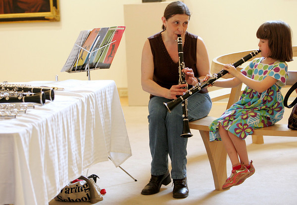 Gloucester:  Theresa Grissino, a clarinet teacher, plays the clarinet with first time player Sarah Robinson, 7, during the Musical Instrument Petting Zoo at the Cape Ann Museum Saturday afternoon.  The Musical Instrument Petting Zoo was just one of the many events held at the Gloucester Public Schools' Arts Festival at locations including the City Hall, The Cape Ann Museum, Sawyer Free Library. Mary Muckenhoupt/Gloucester Daily Times