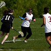 Gloucester: Gloucester's Candice Stuart, center, runs past Cambridge's Abigail Quinn as teammate Miha Watanabe looks on at Magnolia Woods yesterday. Photo by Kate Glass/Gloucester Daily Times Monday, May 18, 2009