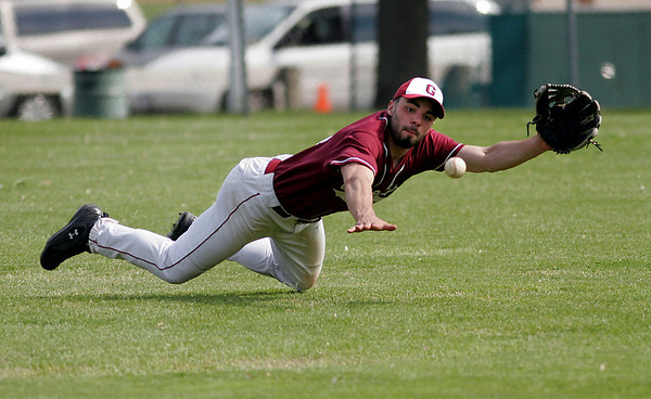 Danvers: Gloucester's Marc Alves makes a diving attempt at a long ball, but it bounced above his glove as the Fishermen play Danvers in the consolation game of the Woodman tournament yesterday. Photo by Kate Glass/Gloucester Daily Times Sunday, May 24, 2009