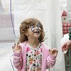 Rockport: Madeline McGrath, 5, laughs with delight after getting her face painted like a butterfly during Motif No. 1 Days in downtown Rockport Saturday afternoon. Mary Muckenhoupt/Gloucester Daily Times