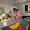 Rockport:  Karen Tusinski works on a painting in her gallery in downtown Rockport Thursday afternoon. Tusinski was in the beginning of her painting process by sketching on her first layer of piant.  Mary Muckenhoupt/Gloucester Daily Times