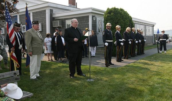 Manchester: Rev. John Gentleman of Sacred Heart Parish delivers an invocation during Manchester's Memorial Day ceremony yesterday morning. Photo by Kate Glass/Gloucester Daily Times