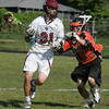 Gloucester: Gloucester's William Deckert cradles the ball past Beverly's Ryan Byors during the lacrosse game at Newell Stadium Thursday afternoon. Mary Muckenhoupt/Gloucester Daily Times