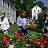 Gloucester: Marlene Dickinson, center, puts out some more flowers as Marty Langlois, left, and Jane Pulkkinen look over their options at the annual Annisquam Plant Sale Saturday morning.  The sale is put on by the Annisquam Sewing Circle which is thought to be one of the oldest continuous ladies benevolent societies in the country.  Mary Muckenhoupt/Gloucester Daily Times