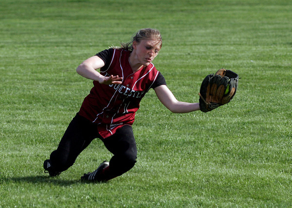 Gloucester: Gloucester right fielder Krystina Novello makes a diving catch as they play Danvers at Burnham Field yesterday afternoon. Photo by Kate Glass/Gloucester Daily Times