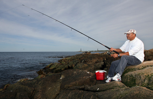 Rockport: Joel Hoya fishes at Loblolly Cove on Monday afternoon. Hoya says he fished from the same spot last year, but was not catching anything on Monday. Photo by Kate Glass/Gloucester Daily Times