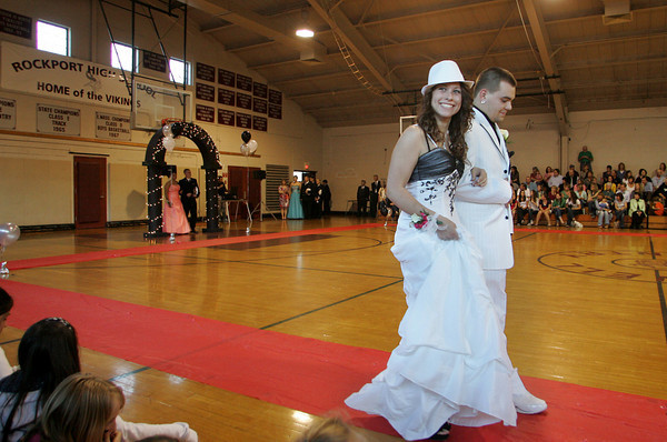 "Rockport: Rockport sophomore Tori Oulton and her date senior Sam Ponte walk the ""red carpet"" at the Rockport High School promenade held in the Stephen Rowell Gymnasium before heading to prom Friday night.  This year's Rockport High School prom was held at the Hawthorne Hotel in Salem. Mary Muckenhoupt/Gloucester Daily Times"