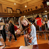 Gloucester: Gloucester fifth grader Genevieve Healey practices her violin moments before the Gloucester City-Wide Band played at City Hall for the Gloucester Public Schools Art Festival Saturday afternoon. Mary Muckenhoupt/Gloucester Daily Times