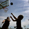 Rockport: Patrick Moroney, 13, shoots over Brendan Thompson, 12, while playing three on three behind Rockport High School Thursday afternoon.  The boys were outside enjoying the nice weather which is expected to continue into next week with a few clouds moving in Saturday and Sunday.  Mary Muckenhoupt/Gloucester Daily Times