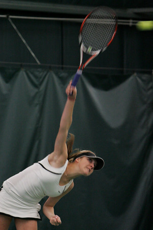 Manchester: Manchester Essex's first singles player Brittany Collens serves the ball to her Wilmington opponent during the tennis match at Manchester Athletic Club Wednesday afternoon. Mary Muckenhoupt/Gloucester Daily Times