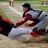 Rockport: Rockport catcher Jay Fulmer gets Amesbury third baseman Matt Enaire out at home plate at Evan's Field yesterday afternoon. Amesbury won 13-7. Photo by Kate Glass/Gloucester Daily Times