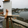 Rockport: Toby Campbell, 8, of Rockport sketches Motif #1 during Motif #1 Day in Rockport on Saturday. Campbell said he had only tried to draw the Rockport landmark once before, when his class went on a field trip to the site. Photo by Kate Glass/Gloucester Daily Times