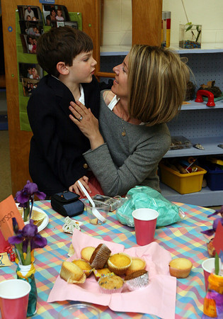Gloucester: Will Andrew climbs into Ann Andrew's lap while attending a Mother's Day breakfast at the Lanesville Preschool Center Monday morning. The students made gifts for their mothers and performed songs. Photo by Kate Glass/Gloucester Daily Times
