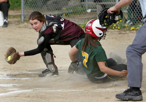 Rockport: Rockport catcher Becca Tibert catches the ball as North Reading's Brittany Venezia slides safely into home during the softball game at Rockport High School Friday afternoon. Mary Muckenhoupt/Gloucester Daily times
