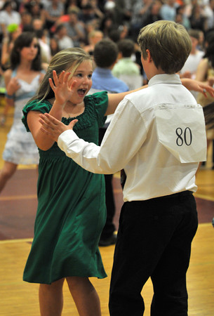 Gloucester: Ts Burnham 10, swing dances with partner Brendan Johnson 9, at the Mad Hot Ball held at the GHS on Sunday afternoon. Desi Smith Photo/Gloucester Daily Times. May 2,2010.