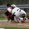 Gloucester: Gloucester shortstop MacKenzie Quinn dives into home plate as Lynn English catcher Roberto Reyes tags him during the third inning yesterday. Quinn was called out at the plate. Photo by Kate Glass/Gloucester Daily Times