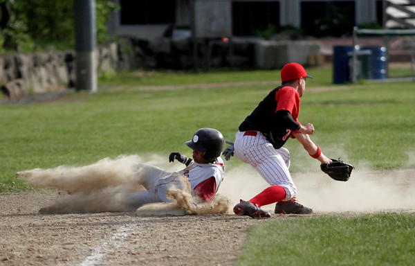 Rockport: Rockport shortstop Andreas Contreras slides safely into third base as Amesbury third baseman Matt Enaire gets the ball late at Evans Field yesterday. Photo by Kate Glass/Gloucester Daily Times