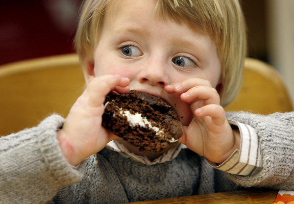 Essex: Fletcher Wilson, 2, of Essex takes a big bite of his whoopi pie as the friends of the TOPHP Burnham Library hold their annual Pie Fest Wednesday afternoon.  All kinds of pies are donated and are sold by the slice to raise money for the library. Mary Muckenhoupt/Gloucester Daily Times