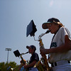 Gloucester: Noah Stevens, 11, of Gloucester plays the saxaphone in his Mariners uniform with the Gloucester city-wide band at Boudreau Field before the first game of the season Saturday afternoon. Mary Muckenhoupt/Gloucester Daily Times