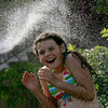 Essex: Austin Pare of Essex gets sprayed down by her grandmother after taking at dip in the Essex River Wednesday afternoon. Mary Muckenhoupt/Gloucester Daily Times