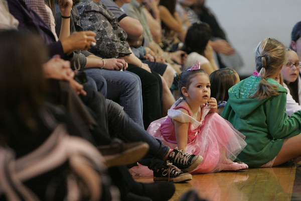 "Rockport: Charlotte Mento, 4, watches the prom goers walk the ""red carpet"" at the Rockport High School promenade held in the Stephen Rowell Gymnasium Friday night.  Mary Muckenhoupt/Gloucester Daily Times"