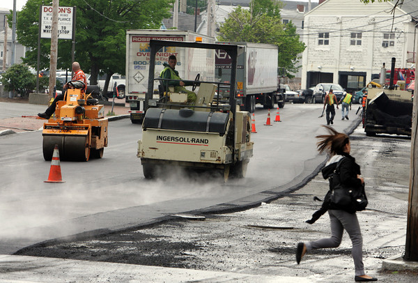 Gloucester: Crews work to pave Rogers Street on Thursday causing many detors to jam up traffic on nearby streets.  Mary Muckenhoupt/Gloucester Daily Times