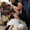 Gloucester: Clara Del Vecchio leaps into the arms of her mother, Michele Del Vecchio, after performing a song about mothers with her fellow classmates at the Lanesville Preschool Center Monday morning. The students hosted their mothers for breakfast to celebrate Mother's Day. Photo by Kate Glass/Gloucester Daily Times