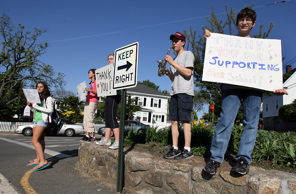 Rockport: From right: Evan Razdan, Alek Razdan, Isabelle Brisson, Z. Lily, and Jamey Ouellette stand at Five Corners in Rockport, thanking residents for voting in favor of the tax override during Tuesday's election. Photo by Kate Glass/Gloucester Daily Times