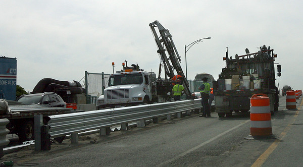 Gloucester: Workers install a guard rail between an existing rail and the new jersey barrier separating north and southbound traffic on the A. Piatt Andrew Bridge yesterday afternoon. All lanes of traffic are expected to be open by the end of the month. Photo by Kate Glass/Gloucester Daily Times