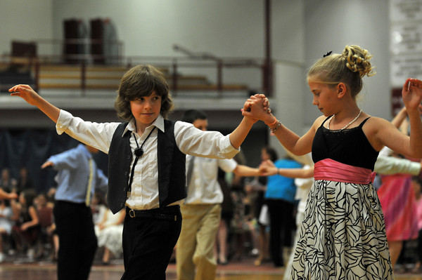 Gloucester: Roman Gadbois 11, and his partner Callie O'Leary 11, dance the Cha- Cha at the Mad Hot Ball held at the GHS on Sunday afternoon. Desi Smith Photo/Gloucester Daily Times. May 2,2010.